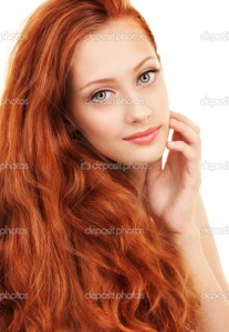 Portrait of a young woman with red hair and green eyes
